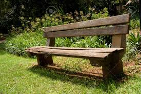 Wooden Park Bench Wooden And Concrete Park Bench In Green Park Outdoors Stock Photo