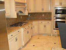 what color cabinets go with venetian gold granite page title