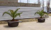 cast iron planter round contemporary for public spaces