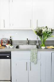 antique white kitchen cabinets with black appliancesantique easy and inexpensive rental kitchen makeover thouswellblog