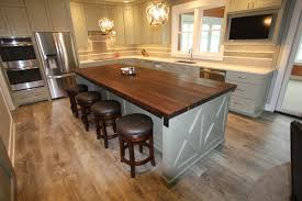 ash wood dark roast raised door kitchen island with butcher block