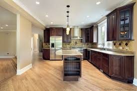 what color kitchen cabinets go with hardwood floors wood cherry kitchen cabinets light floors and light