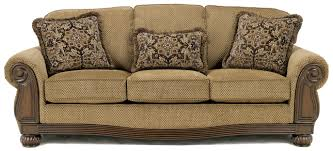 signature design by ashley camden sofa signature design by ashley lynnwood amber sofa with carved wood