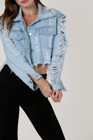 light blue cropped jean jacket trendy cropped denim jacket with intense distressing and frayed raw