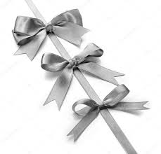 white silk ribbon silver silk ribbon with beautiful bows stock photo belchonock