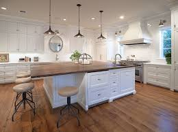 white kitchen island with top 20 gorgeous ways to add reclaimed wood to your kitchen