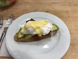 sur la table toaster eggs benedict over avocado toast w bacon my favorite yelp