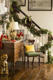 house staircase with white railing and decorated with garland