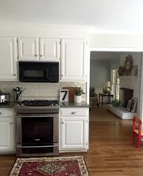 white kitchen cabinets with backsplash our white kitchen cabinets granite emily a clark