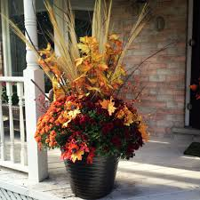 fall planters using grasses coleus pink mums ornamental cabbage