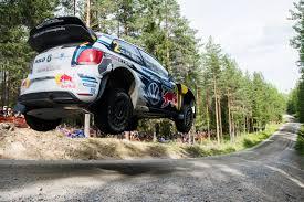 porsche rally car jump briton wins rally finland autoworld com my