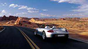 paul walker porsche fire red porsche carrera gt wallpaper image 80