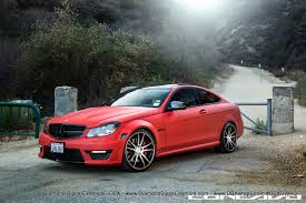 bagged mercedes e class mercedes benz c63 amg wrapped in ultra matte red by dbx diamond
