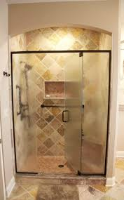 glass shower doors enclosures installation syracuse cny framed embossed glass panels with a centered door provide easy access and privacy textured glass