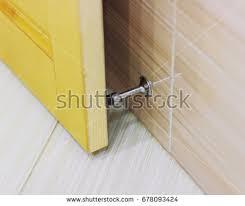 door stopper stainless door stop door stopper stock photo 678093424 shutterstock