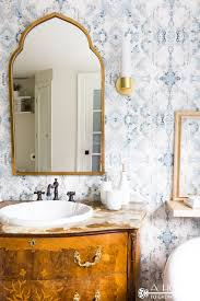 the latest bathroom design trends round mirrors bold fixtures