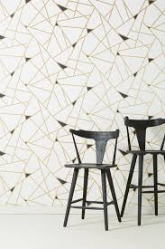 design house skyline yellow motif wallpaper white wallpaper anthropologie