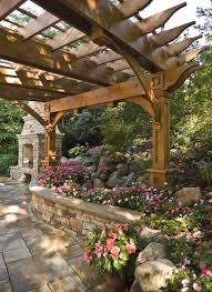 Pictures Of Pergolas In Gardens by Stone Wall With Bench Top Along With Raised Flower Beds To Make