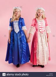 dresses for halloween portrait of two girls 10 11 in colonial princess dresses for