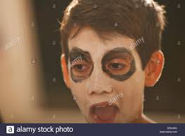 How To Paint A Skeleton Face For Halloween by Close Up Of Boy With Skeleton Face Paint For Halloween Stock Photo