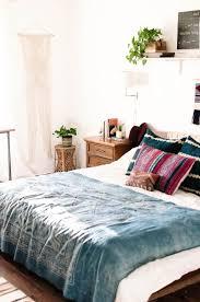 bedroom cozy bohemian bedroom design using white and blue blanket