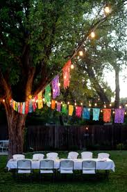 sparkling 30th birthday party backyard string lights and balloon