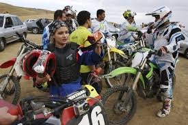 motocross bikes philippines in iran female motocross racer jumps barriers