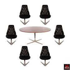 chromcraft sculpta dining room set with six black swivel chairs