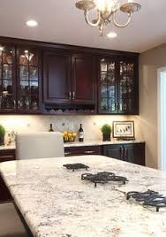 dark cabinets grey countertops and light wood floors for the