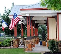 Porch Flags Bastrop Frontier Bank Of Texas