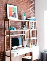 a corner in the livingroom with a standing desk where you can read
