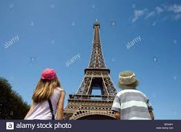 The Eiffel Tower by Paris France A Boy And Looking Up At The Eiffel Tower Mr