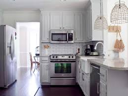 greyish white kitchen cabinet with metal collection and make a