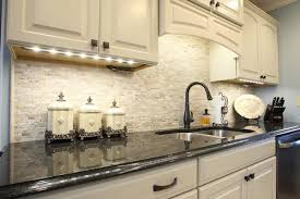 backsplash ideas for white cabinets and black countertops travertine tile backsplash ideas in exclusive kitchen designs