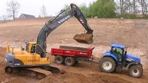 volvo tractor price volvo ec210b excavator loading john deere and new holland tractors