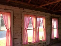 use the red gingham curtains in the sunroom in the cottage instead