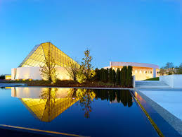ismaili center in toronto is topped with a stunning angular glass