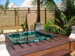 adding a patio spa to your backyard cornerstone properties