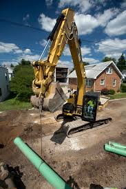 how to safely lift loads with excavators and backhoe loaders