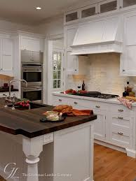 kitchen with white cabinets and wood countertops 12 wow worthy woods for kitchen countertops bob vila