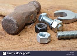 Table Top Fasteners by Macro Shot Of Some Tools With Bolts And Nuts On A Wooden Table Top