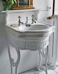pedestal sink top but on an old sewing machine stand painted