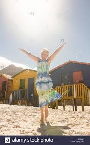 raised beach house stock photos raised beach house stock images portrait of smiling senior woman with arms raised walking on sand at beach on sunny day