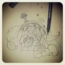 realistic roses and broken clock tattoos on forearm tattoobite com