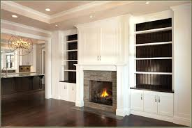 built fireplace mantel with bookshelves in tv entertainment