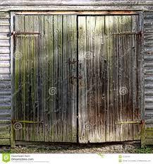 Wooden Barn Door by Antique Wood Barn Door On Historic Farm Building Royalty Free
