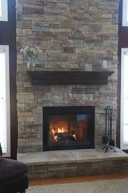 stone veneer mountain stack style dark cherry stained mantle