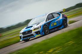 green subaru wrx video mark higgins smashes isle of man record in subaru wrx sti