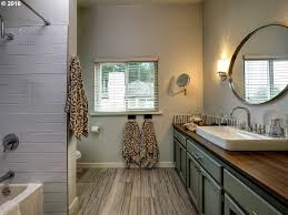 full bathroom with rain shower head u0026 specialty tile floors in