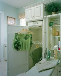 folding hanging drying with light blue laundry room traditional